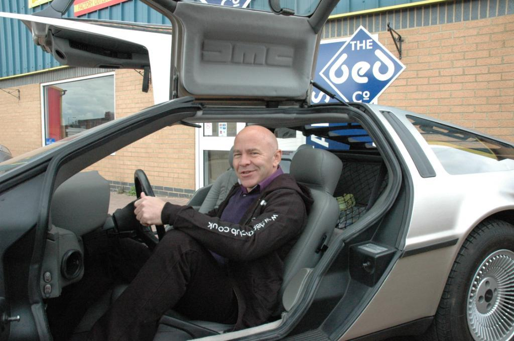 Dominic Littlewood takes a ride in a DeLorean