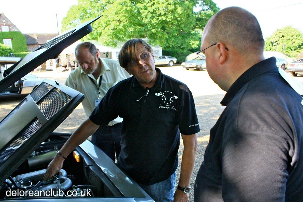 Stephen Wynne, owner of DMC chats to DeLorean Club members